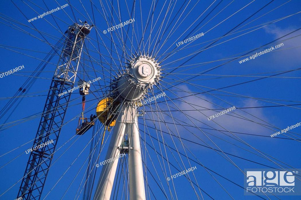 Stock Photo: Crane inspection of hub on London Eye, Millennium Wheel just after erection.