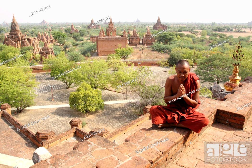 Stock Photo: Monk in meditation at Dhamma yazika stupa pagoda, Bagan, Myanmar Burma.