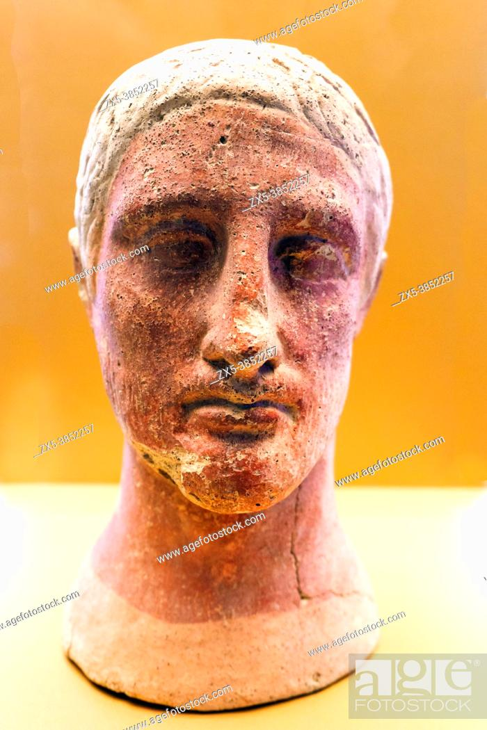 Stock Photo: Terracotta male head with traces of red pigmentation from the votive deposit at the altar of the queen (4th - 3rd cent. BC) - Tarquinia National Archaeological.