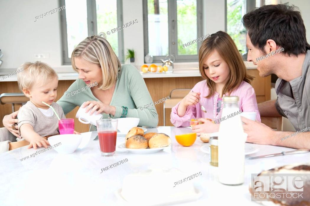 Stock Photo: Family at a breakfast table.