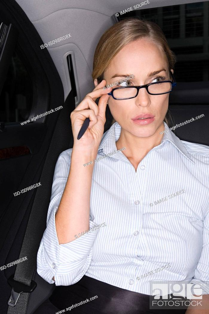 Stock Photo: Businesswoman adjusting her eyeglasses.