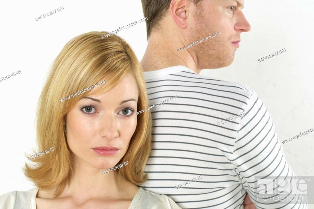 Stock Photo: Frustrated couple standing back to back.