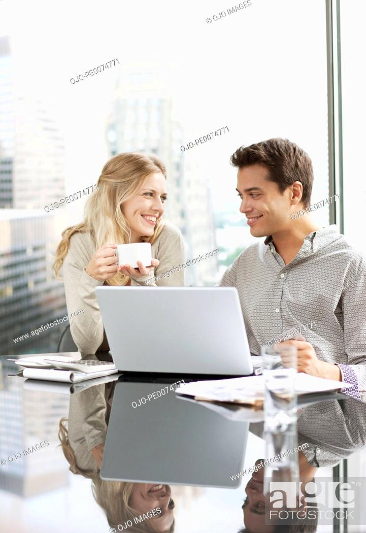 Stock Photo: Business people working together on laptop.