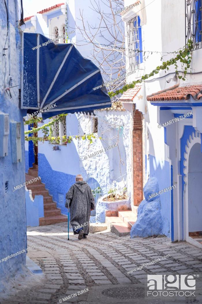 Stock Photo: Pedestrians in a blue alley in Chefchaouen, Morocco, North Africa, Africa.