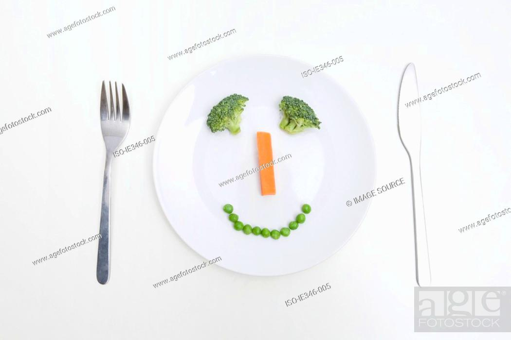 Stock Photo: A smiley face of vegetables.