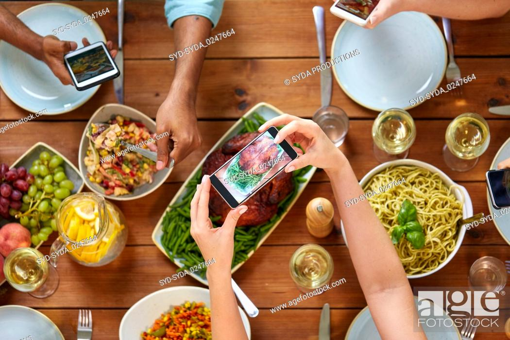 Stock Photo: people with smartphones photographing food.
