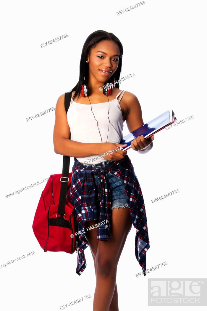 Stock Photo: Beautiful happy student standing with binders and bag, on white.