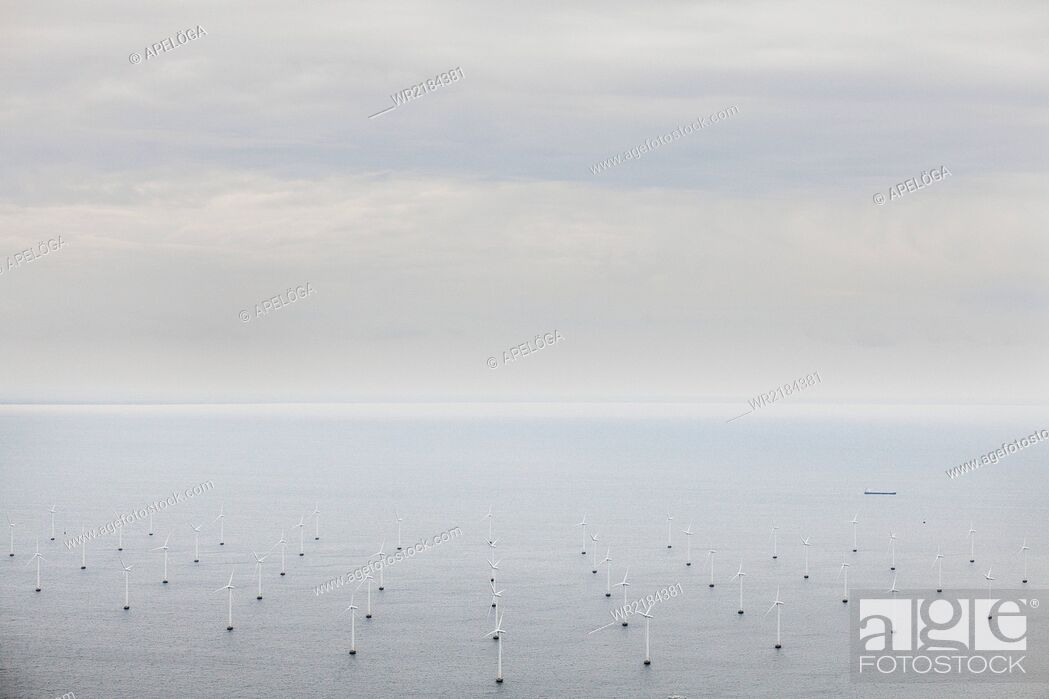 Stock Photo: Aerial view of windmills in sea against sky.