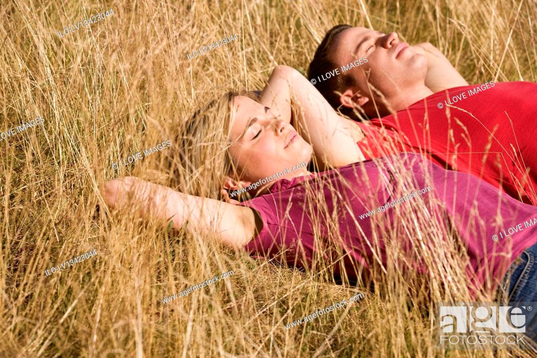 Stock Photo: A young couple lying side by side in the sun.