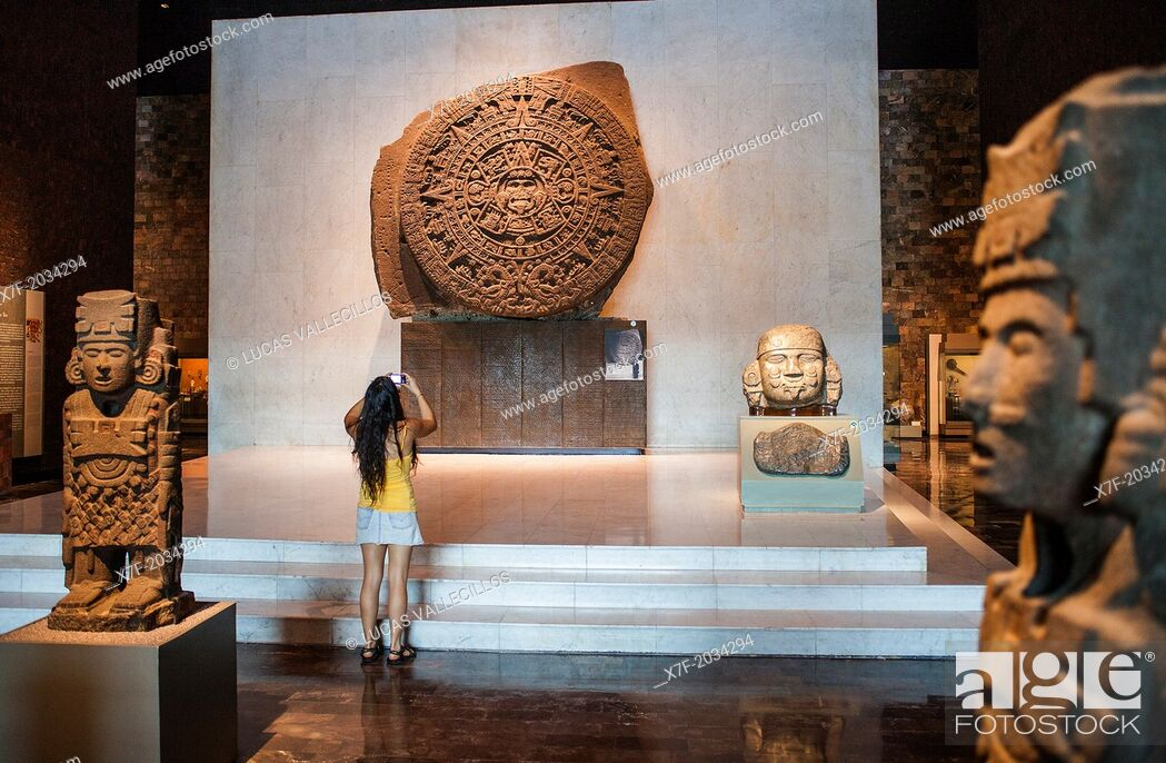 Stock Photo: The Aztec Stone of the Sun and other artifacts on display at National Museum of Anthropology, Mexico City, Mexico.