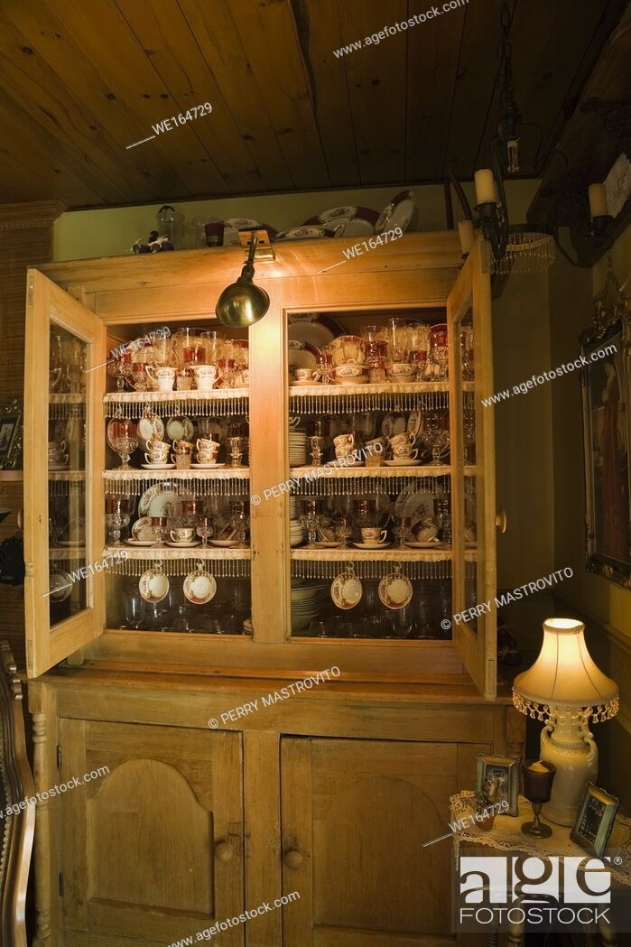 Stock Photo: Antique buffet in the living room of an old Canadiana log home, Quebec, Canada.