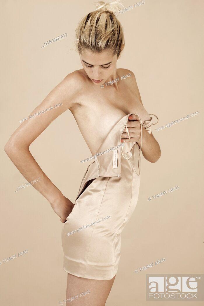 Stock Photo: woman undressing.