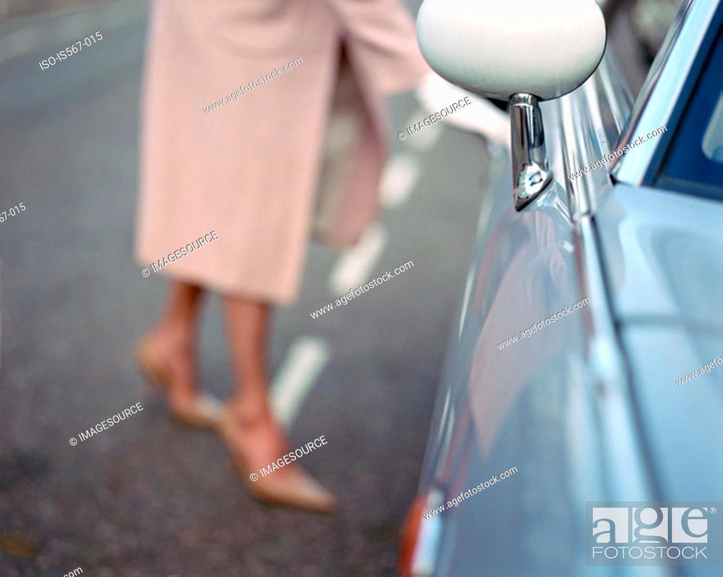 Stock Photo: Woman opening automobile door.