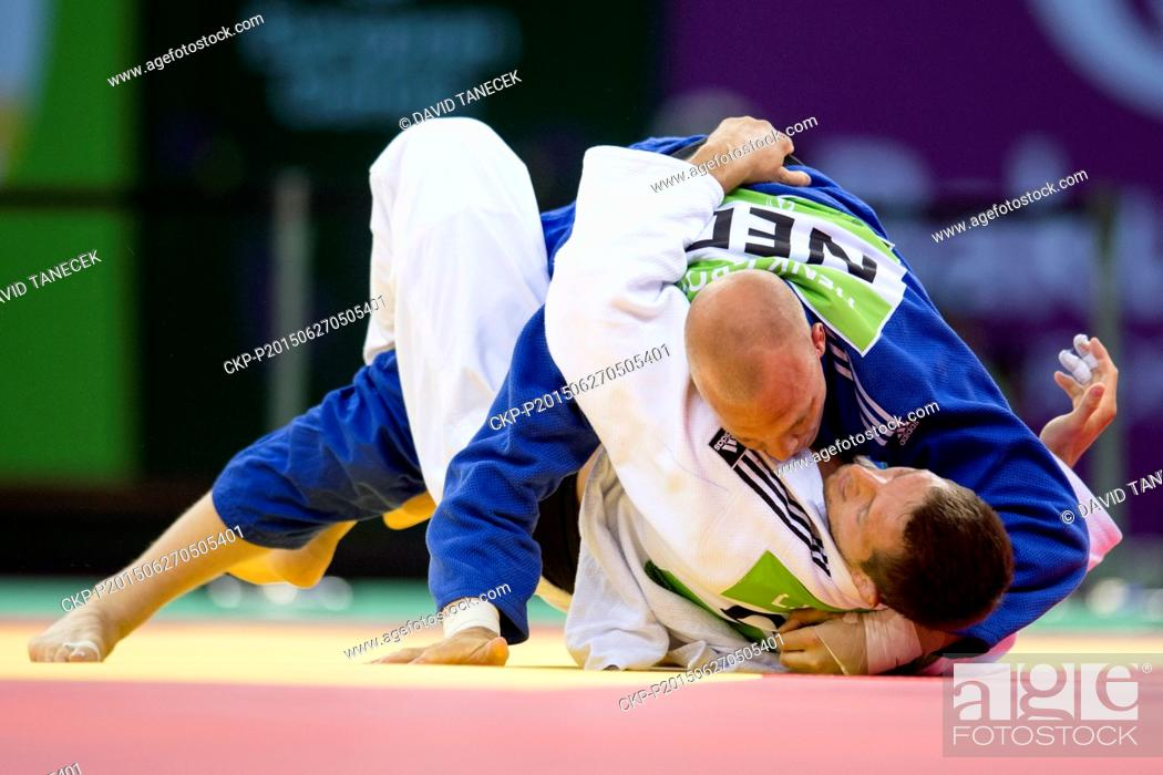 Stock Photo: Lukas Krpalek (in white) from Czech Republic and Henk Grol from Netherlands fight during the Men's Judo under 100kg final in Heydar Aliyev Arena at the Baku.
