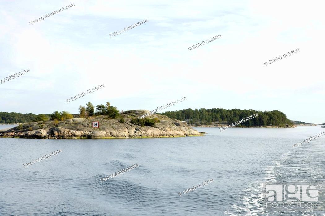 Stock Photo: Rocky island in lake.