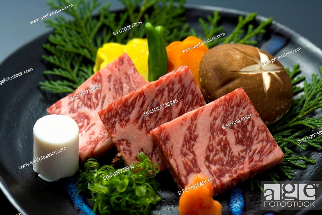 Stock Photo: Slices of raw beef and vegetables on a plate, high angle view, close up, Japan.