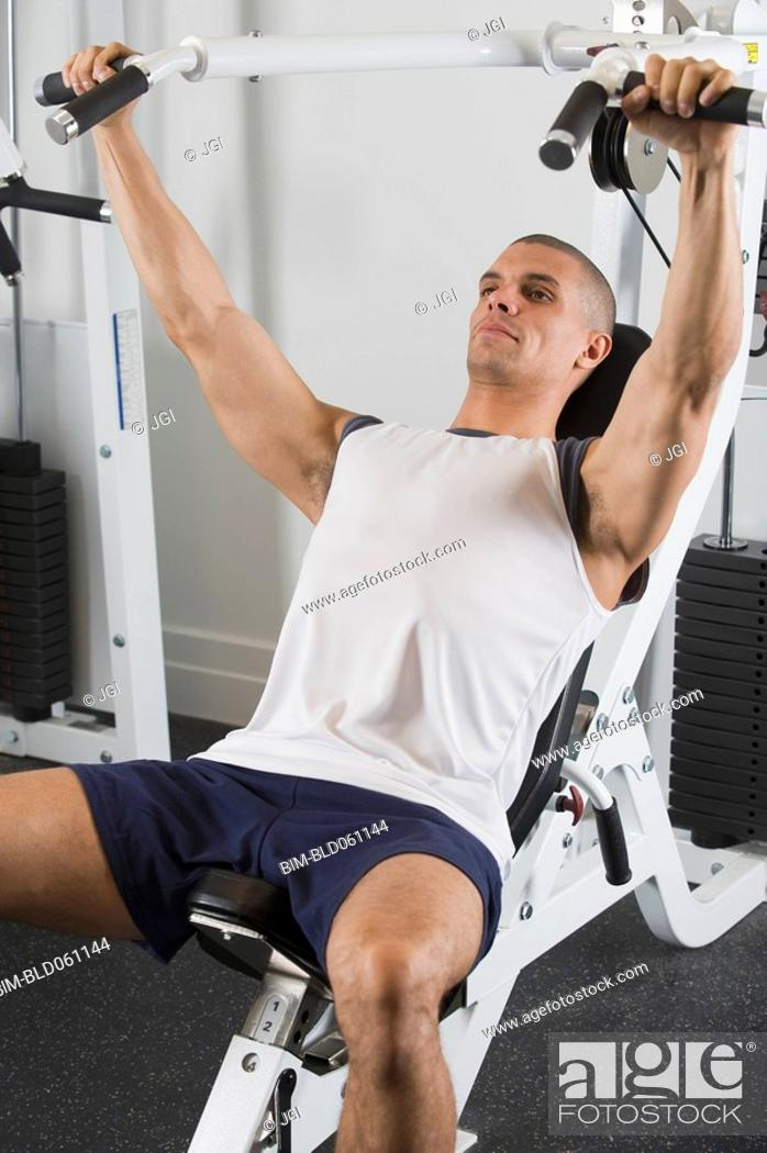 Stock Photo: Hispanic man exercising in gym.