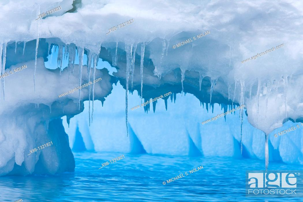 Stock Photo: Iceberg detail in and around the Antarctic Peninsula during the summer months  More icebergs are being created as global warming is causing the breakup of major.
