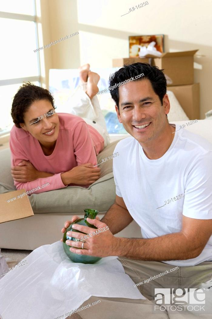Stock Photo: Couple unpacking things in new home.
