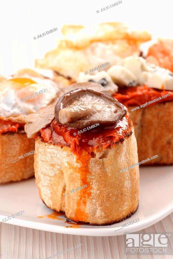 Photo de stock: Spanish tapas on bread.