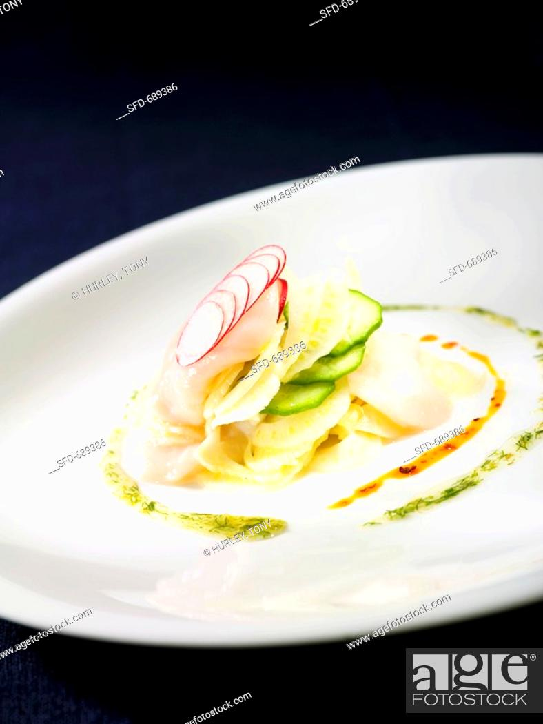 Stock Photo: Scallop Ceviche Salad with Fennel, Cucumber and Radish, Chili Oil on White Plate.