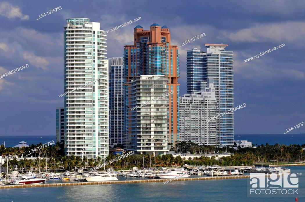Stock Photo: Views of Miami Florida skyline and harbor from departing cruise ship.