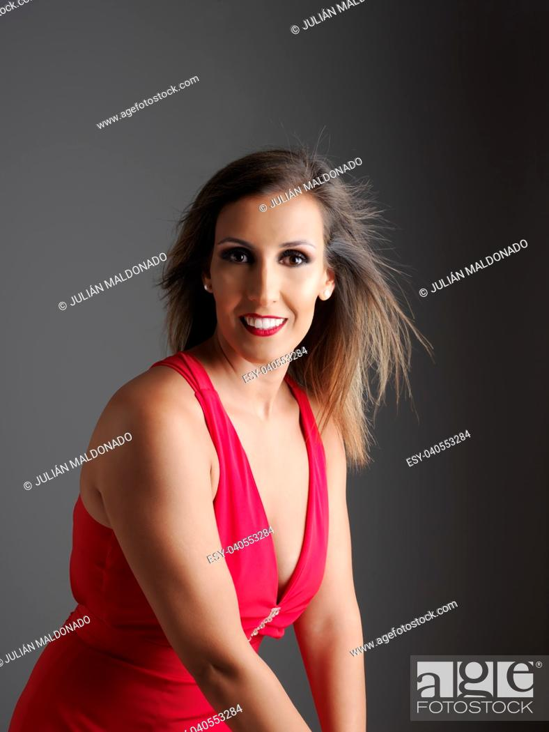 Stock Photo: Young and pretty woman with red dress.