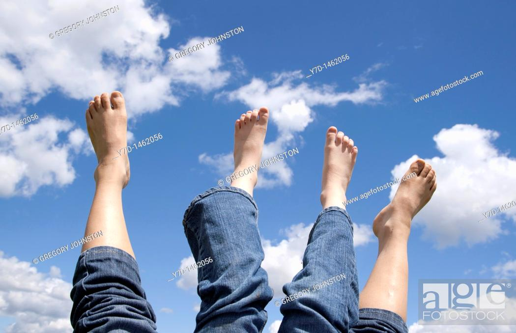 Stock Photo: Feeling relaxed and letting the bare feet air out in the sun.