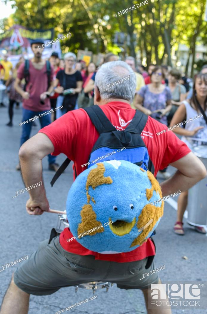 Stock Photo: Madrid, Spain, 27th September 2019. View of people with drums protesting against climate change in Paseo del Prado, Madrid city, Spain.
