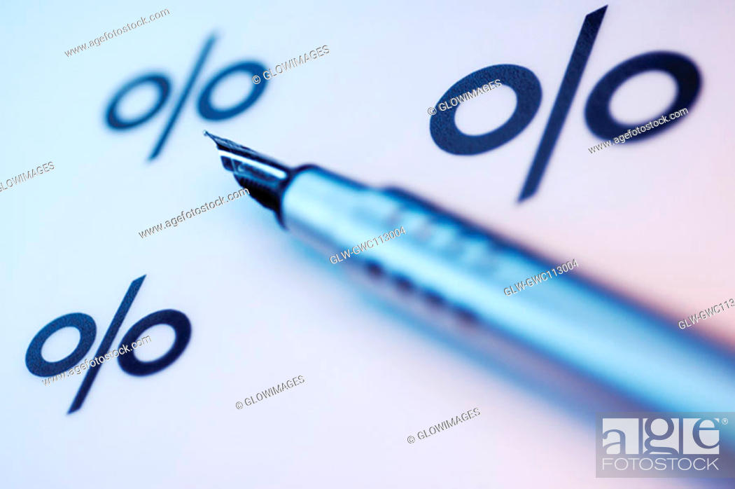 Stock Photo: Close-up of a fountain pen and percentage signs.