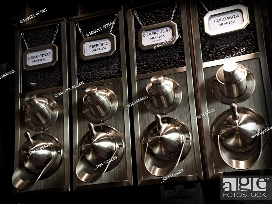 Stock Photo: Grinders and metal dispensers difrentes types of coffee.