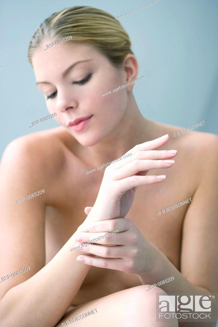 Stock Photo: PAINFUL WRIST IN A WOMAN Model.