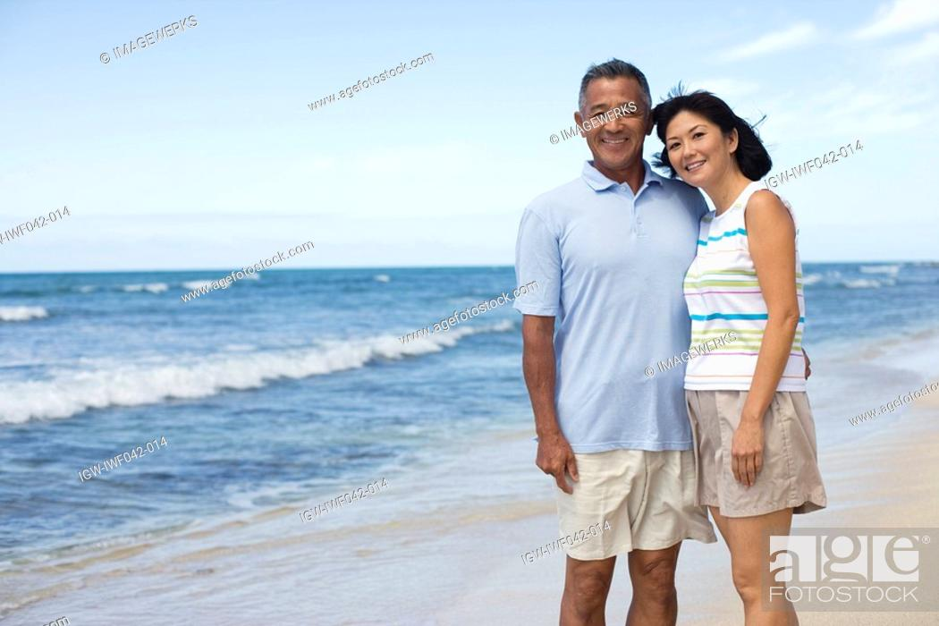 Stock Photo: A couple smiling at beach.
