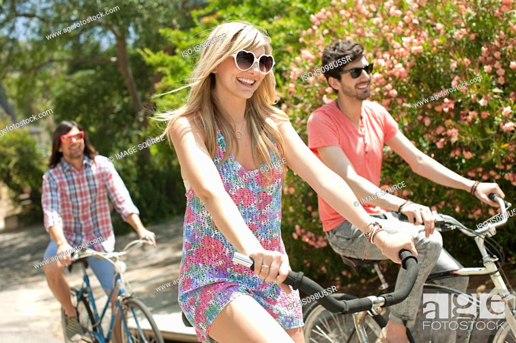 Stock Photo: Young friends cycling on vacation.