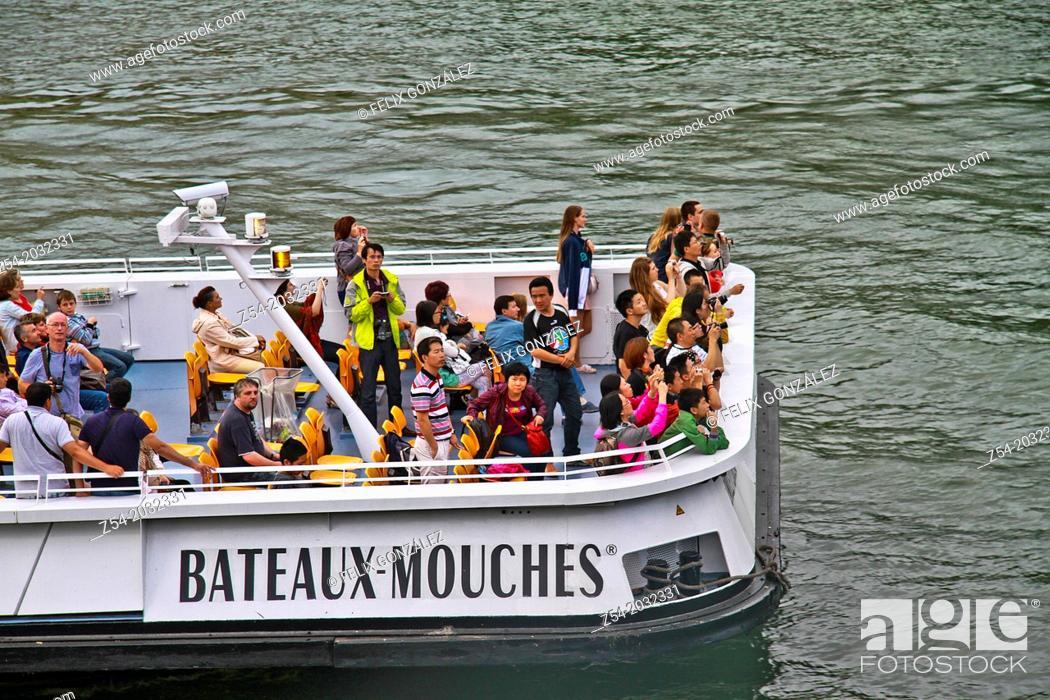 Stock Photo: Toursits at Bateaux Mouches, Paris, France.