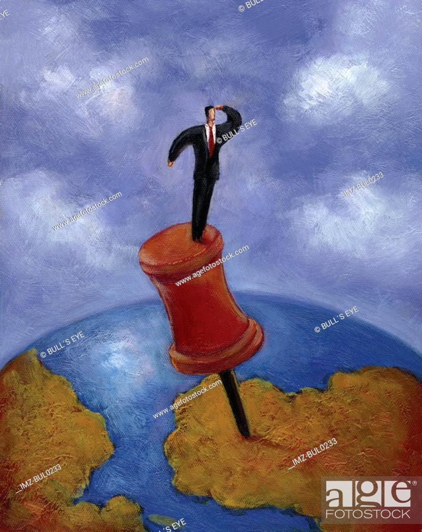 Stock Photo: Businessman looking out while standing on giant thumbtack placed on earth.