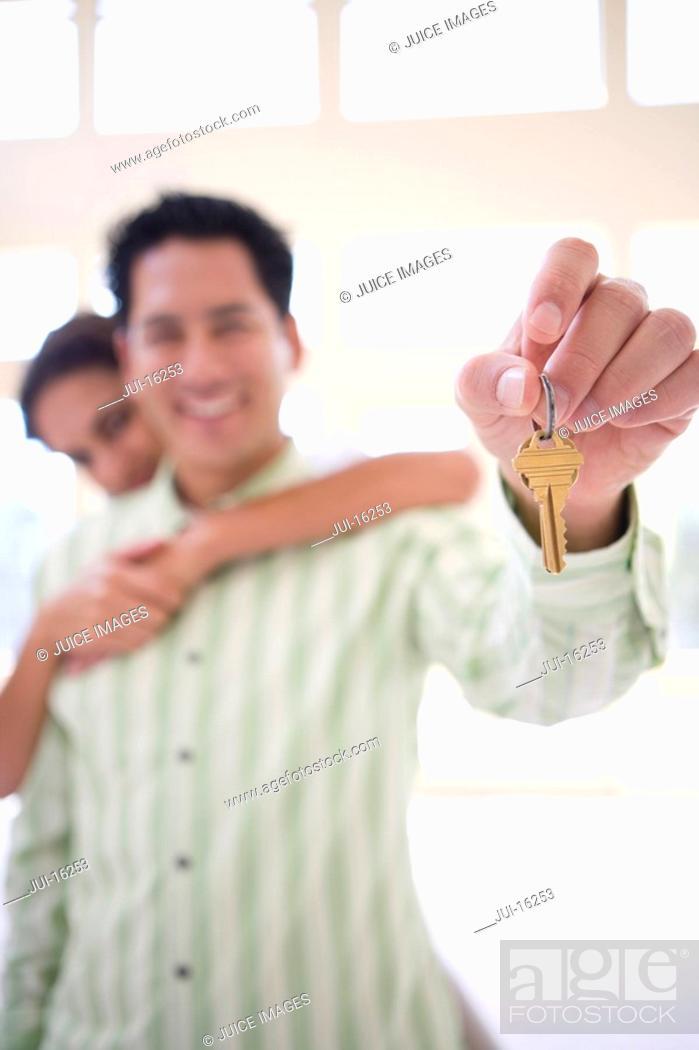 Stock Photo: Man holding keys to new home.