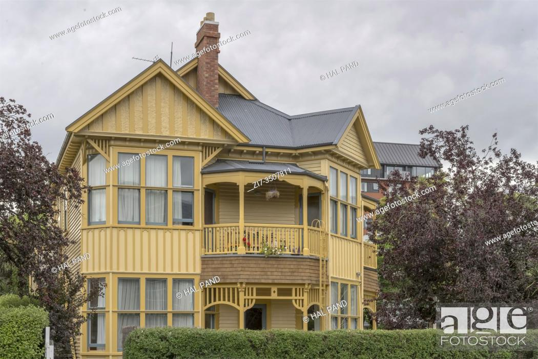 Stock Photo: cityscape with traditional wooden Victorian two-storey house, shot in bright spring cloudy light at Christchurch, South Island, New Zealand.