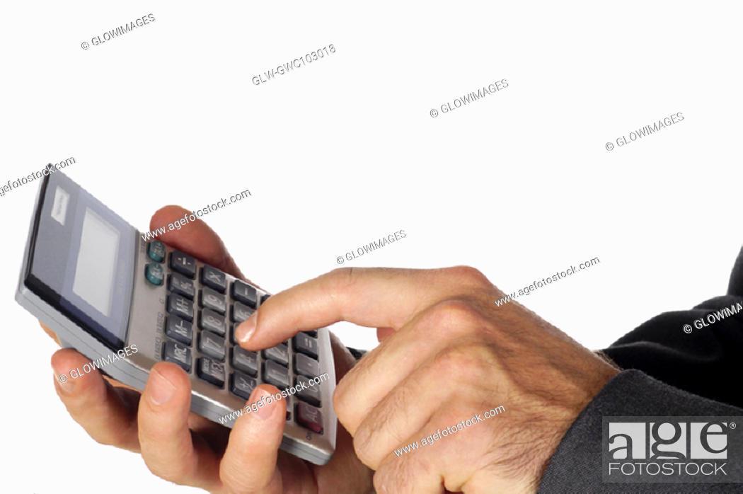 Stock Photo: Close-up of a businessman using a calculator.