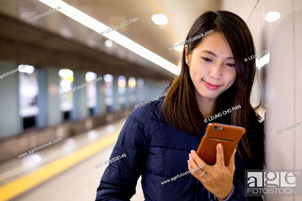 Stock Photo: Woman use of cellphone in platform.