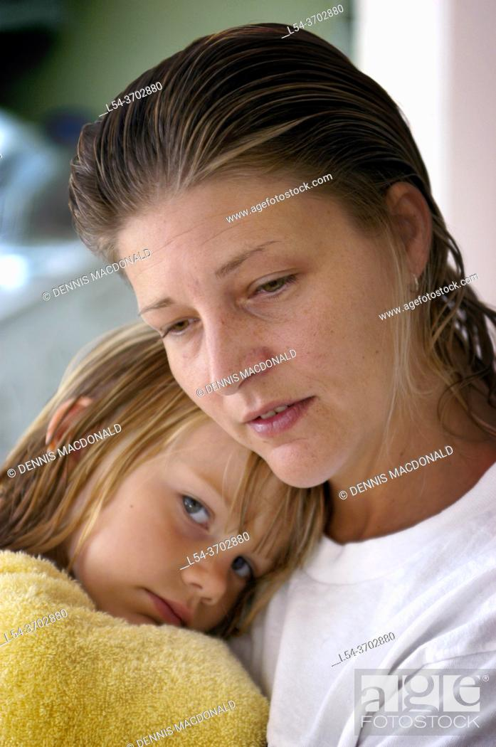 Stock Photo: Mother and 5 year old child in a pensive setting.