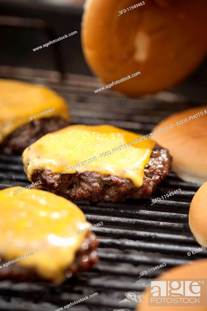 Stock Photo: No People, Close-Up, Motion, Moving, Heat, Indoors, Interior, Near, Inside, Roll, Food, Meat, Dish, Cuisine, Action, Prepared, Grilled, Nutrition, Melt, Melting, Photo, Make, Rack, Burger, Hamburger, Focus, Cheese, Barbecue, Grill, Grilling