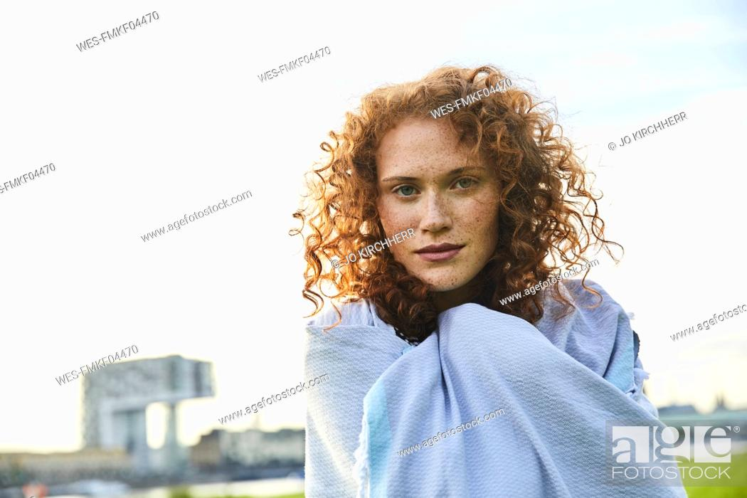 Stock Photo: Germany, Cologne, portrait of freckled young woman.