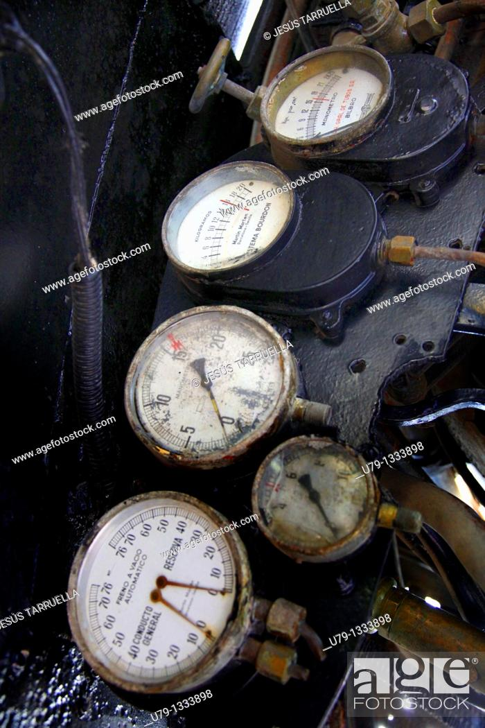 Stock Photo: Gauges indicators in the control panel of a machine of old steam train.