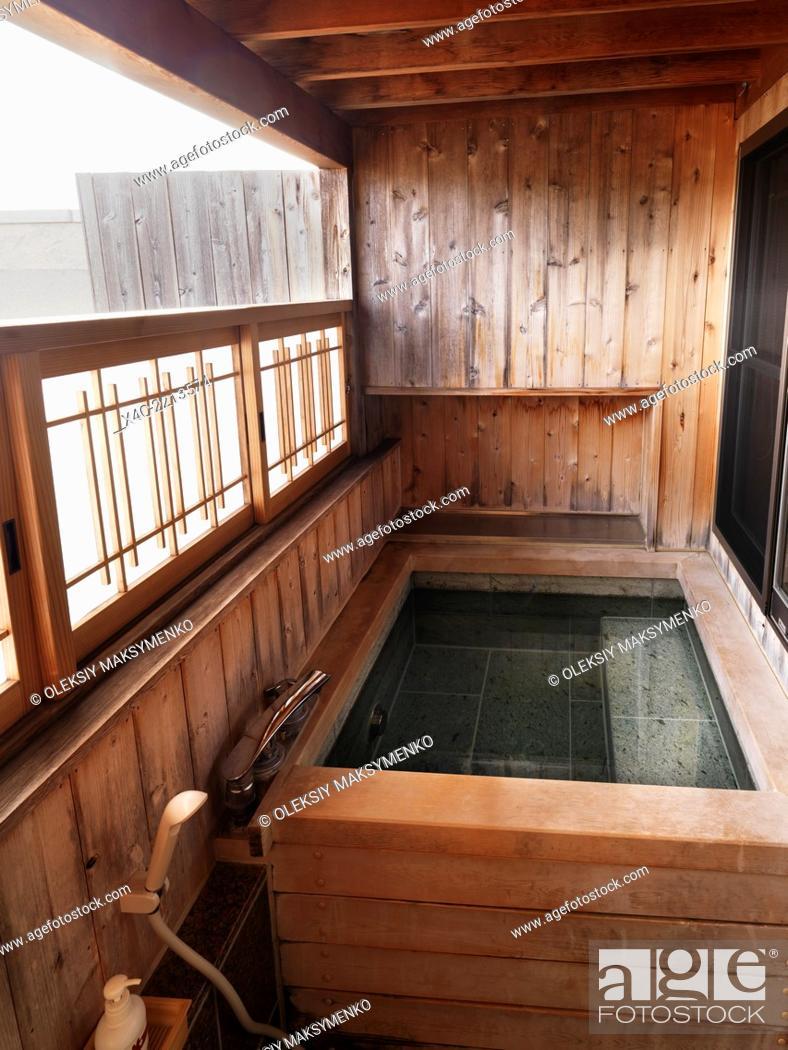 Onsen, private hot spring bath tab at a ryokan traditional Japanese ...