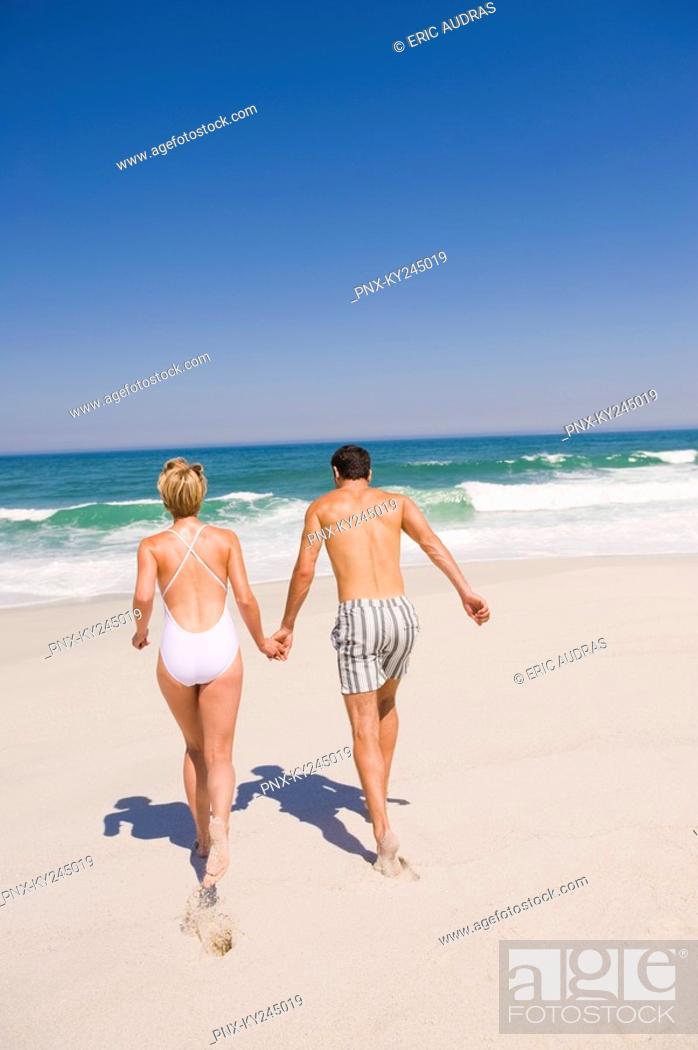 Stock Photo: Couple running on the beach.