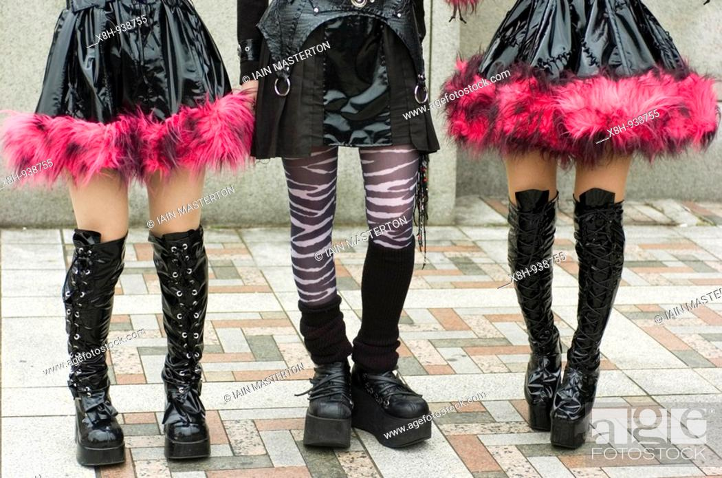 Stock Photo: Young girls legs dressed as cosplay goths at Harajuku in central Tokyo Japan.