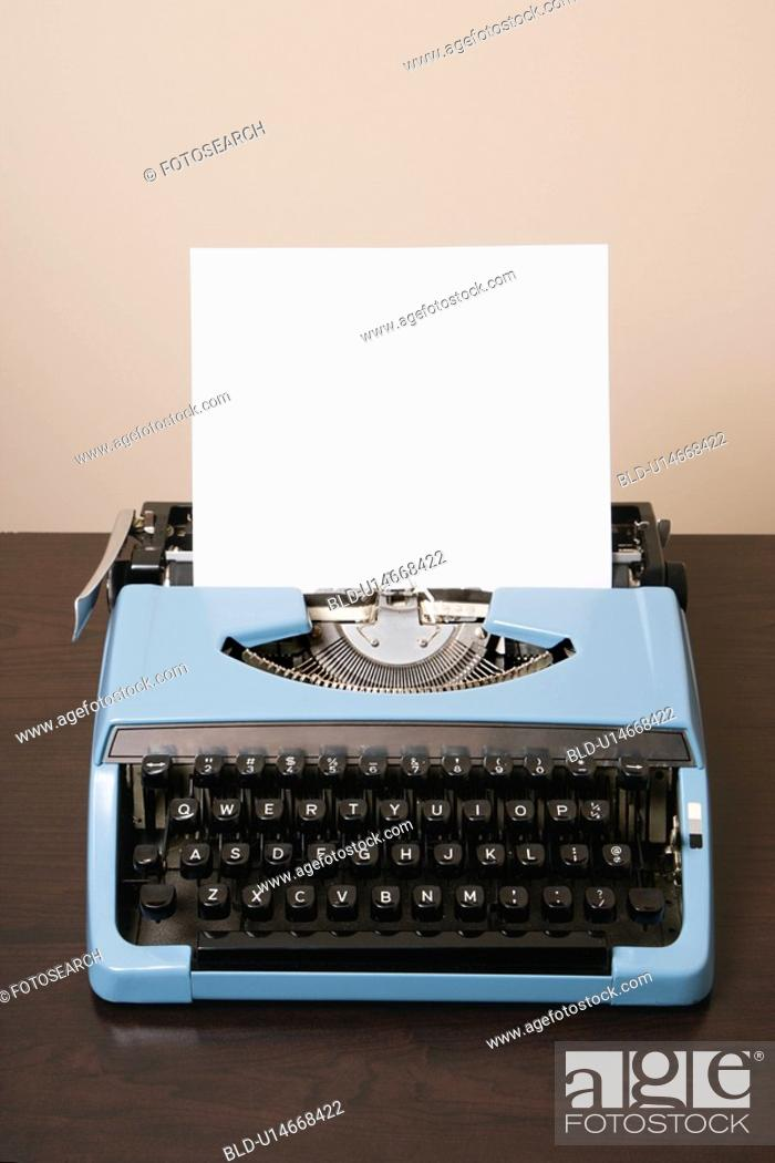 Stock Photo: Blank sheet of paper in an old fashioned typewriter.