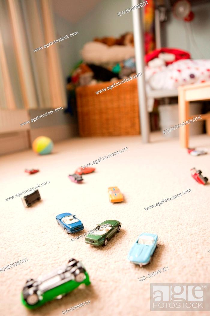 Stock Photo: Toy cars scattered across a child's bedroom.