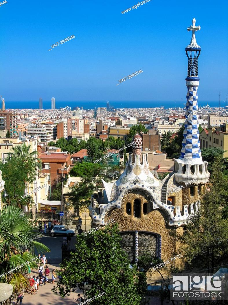 Stock Photo: View of city of Barcelona from Parc Guell, Barcelona, Spain, Europe. Image taken from steps above the main entrance gate in front of one of the pavillions.